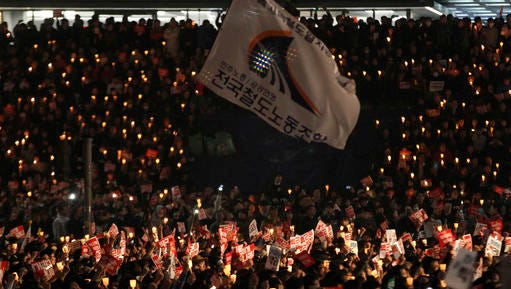 """South Korean protesters stage a rally calling for South Korean President Park Geun-hye to step down in downtown Seoul, South Korea, Saturday, Nov. 5, 2016. Tens of thousands of South Koreans poured into the streets of downtown Seoul on Saturday, using words including """"treason"""" and """"criminal"""" to demand that Park step down amid an explosive political scandal."""