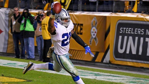 Dallas Cowboys running back Ezekiel Elliott (21) celebrates after scoring a touchdown during the second half of an NFL football game against the Pittsburgh Steelers in Pittsburgh, Sunday.