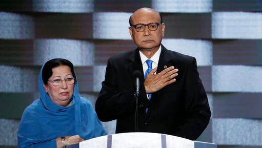 FILE - In this July 28, 2016, file photo, Khizr Khan, father of fallen Army Capt. Humayun Khan and his wife Ghazala speak during the final day of the Democratic National Convention in Philadelphia. Random House says it plans to publish a memoir by Khiz Khan. The company said Wednesday, Nov. 23, in a news release that the untitled memoir is to be published in the fall of 2017. It also said Ghazala Khan, will contribute.