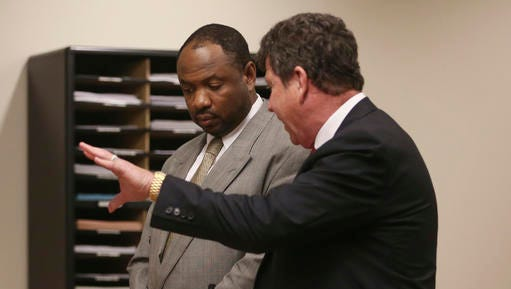 Kevin Roper, a Wal-mart truck driver charged in the 2014 Turnpike accident that injured comedian Tracy Morgan and killed his friend, talks to his Attorney David Glassman as he pleaded guilty to vehicular homicide and other charges at the Middlesex County Courthouse Tuesday, Nov. 29, 2016, in New Brunswick, N.J. Under terms of his plea, he can avoid prison if he performs community service and satisfies other conditions over the next three years.