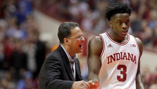 Indiana head coach Tom Crean, left, talks with OG Anunoby during the first half of an NCAA college basketball game against the North Carolina Wednesday, Nov. 30, 2016, in Bloomington, Ind. (AP Photo/Darron Cummings)