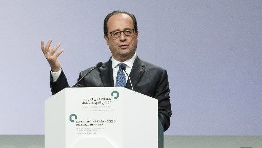In this Saturday Dec. 3, 2016 photo released by Emirates News Agency, WAM, French President Francois Hollande, makes his speech during the Safeguarding Endangered Cultural Heritage Conference at Emirates Palace in Abu Dhabi, United Arab Emirates.