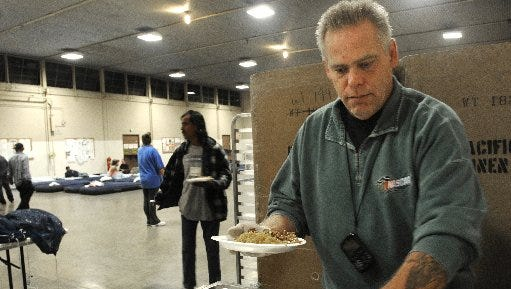 A volunteer at the homeless shelter in Oxnard is seen in this file photo. The 2016 winter warming shelter was opened on Tuesday.