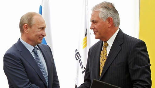 FILE- In this June 15, 2012, file photo, Russian President Vladimir Putin, left, and ExxonMobil CEO Rex Tillerson shake hands at a signing ceremony of an agreement between state-controlled Russian oil company Rosneft and ExxonMobil at the Black Sea port of Tuapse, southern Russia. President-elect Donald Trump selected Tillerson to lead the State Department on Monday, Dec. 12, 2016.