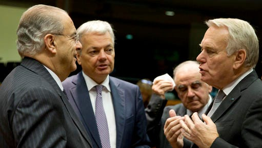Cypriot Foreign Minister Ioannis Kasoulides, left, speaks with, from left, Belgian Foreign Minister Didier Reynders, Malta's Foreign Minister George Vella and French Foreign Minister Jean-Marc Ayrault during a round table meeting of EU foreign ministers at the EU Council building in Brussels on Monday, Dec. 12, 2016. EU foreign ministers hold talks Monday on the conflict in Syria, relations with Africa and migration.
