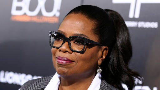 "FILE - In this Oct. 17, 2016 file photo, Oprah Winfrey attends the world premiere of ""BOO! A Madea Halloween"" in Los Angeles. Winfrey has a new book imprint called An Oprah Book under Flatiron Books. The first release will be Winfrey's ""Food, Health and Happiness"" cookbook,  coming out Jan. 3."