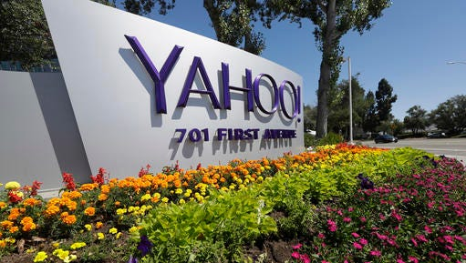 FILE - This Tuesday, July 19, 2016 photo shows a Yahoo sign at the company's headquarters in Sunnyvale, Calif. On Wednesday, Dec. 14, 2016, Yahoo said it believes hackers stole data from more than one billion user accounts in August 2013.
