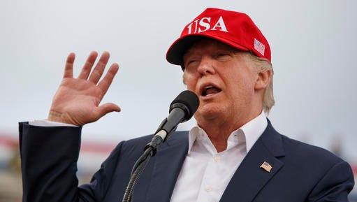 FILE - In this Saturday, Dec. 17, 2016, file photo, President-elect Donald Trump speaks during a rally at Ladd-Peebles Stadium in Mobile, Ala. Trump is poised to meet with his incoming national security adviser on Wednesday, Dec. 20, in the aftermath of a rattling day of violence around the world.