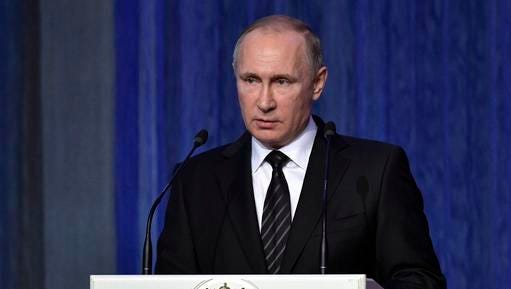 Russian President Vladimir Putin speaks at an annual meeting marking a professional holiday for Russian security service employees in Moscow, Russia, Tuesday, Dec. 20, 2016.