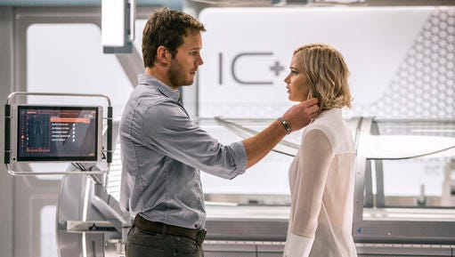 This image released by Columbia Pictures, Chris Pratt, left, and Jennifer Lawrence in a scene from the film, Passengers.""