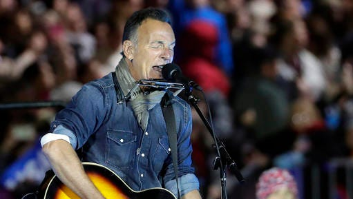 "FILE - In this Nov. 7, 2016, file photo Bruce Springsteen performs during a Hillary Clinton campaign event at Independence Mall in Philadelphia. During an interview on Marc Maron's ""WTF"" podcast released Monday, Jan. 2, 2016, Bruce Springsteen questioned whether President-elect Donald Trump ""is simply competent enough to do this particular this particular job."""