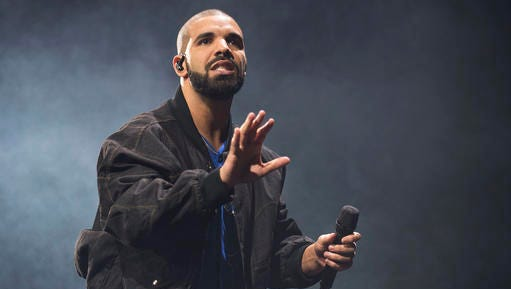 FILE - In this Oct. 8, 2016 file photo, Drake performs onstage in Toronto. Drake leads the nominations for the 2017 iHeartRadio Music Awards with 12, including male artist of the year, announced Wednesday, Jan. 4, 2017.
