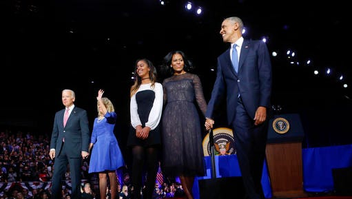 President Barack Obama walks on stage with first lady Michelle Obama, daughter Malia, Vice President Joe Biden and his wife Jill Biden after his farewell address at McCormick Place in Chicago, Tuesday, Jan. 10, 2017.