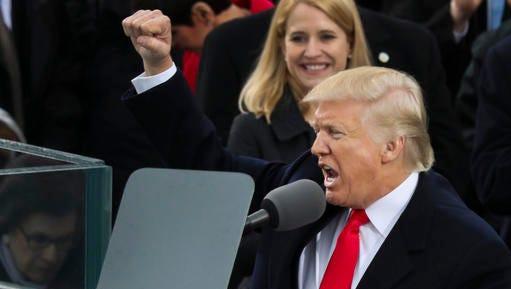 President Donald Trump pumps his first at the end of his speech after bring sworn in as the 45th president of the United States during the 58th Presidential Inauguration at the U.S. Capitol in Washington, Friday, Jan. 20, 2017.