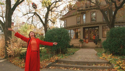 "This photo taken in 1996 shows Mary Tyler Moore tossing her hat up as she revisits the Minneapolis Kenwood neighborhood house which was her television ""home"" for the television show The Mary Tyler Moore Show some 25 years ago."