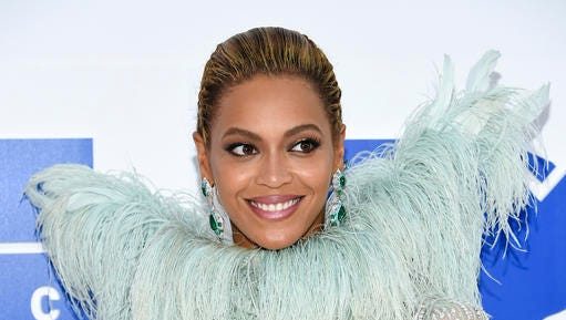 FILE - In this Aug. 28, 2016 file photo, Beyonce Knowles arrives at the MTV Video Music Awards at Madison Square Garden, in New York. Beyonce announced on her Instagram account, Wednesday, Feb. 1, 2017, that she is expecting twins.