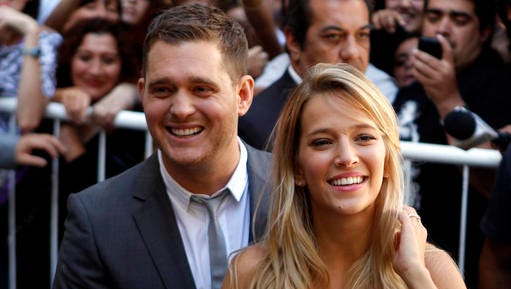 """FILE - This March 31, 2011 file photo shows Canadian pop star Michael Buble, left, Argentine actress Luisana Lopilato in Buenos Aires, Argentina. Buble and Lopilato said on Feb. 3, 2017, that their 3-year-old son Noah """"has been progressing well during his treatment"""" for cancer."""