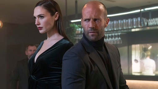 This photo provided by Wix shows a still from the company's first Super Bowl 51 spot featuring Gal Gardot and Jason Statham. The New England Patriots face the Atlanta Falcons in Super Bowl 51, on Sunday, Feb. 5, 2017.
