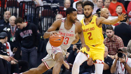 Ohio State's JaQuan Lyle, left, drives to the basket against Maryland's Melo Trimble during the first half of an NCAA college basketball game, Tuesday, Jan. 31, 2017, in Columbus, Ohio. (AP Photo/Jay LaPrete)