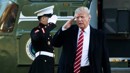 President Donald Trump salutes a Marines honor guard as he disembarks from Marine One upon arrival at the White House in Washington, Monday, Feb. 6, 2017 from a trip to Florida.