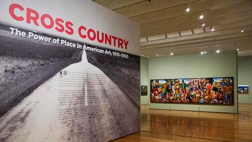"""In this Monday, Feb. 6, 2017 photo, the entrance to the exhibit """"Cross Country: The Power of Place in American Art, 1915-1950,"""" is seen at the High Museum of Art in Atlanta. The new exhibition at takes a look at how American artists during the modernist period traveled outside cities to find inspiration in the rural landscape."""