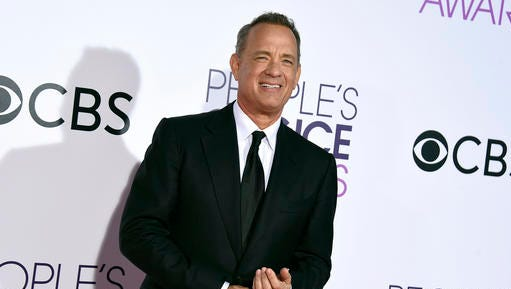 "FILE - In this Wednesday, Jan. 18, 2017, file photo, Tom Hanks arrives at the People's Choice Awards at the Microsoft Theater in Los Angeles. The Oscar-winning actor's first book, ""UNCOMMON TYPE: Some Stories,"" features 17 stories, each in some way involving a different typewriter. It's due out Oct. 24, 2017, from Alfred A. Knopf."