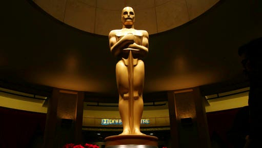 FILE - This Feb. 21, 2015 file photo shows an Oscar statue as preparations are made for the 87th Academy Awards in Los Angeles.   The 89th Academy Awards will be held on Sunday.