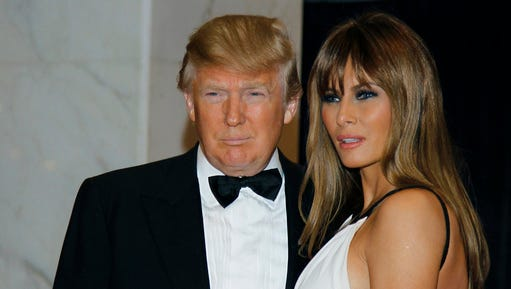 """FILE - In this April 30, 2011, file photo Donald Trump, left, and Melania Trump arrive for the White House Correspondents Dinner in Washington. President Donald Trump says he won't be attending the annual White House Correspondents' Association dinner this spring. In a tweet on Saturday, Feb. 25, 2017, the president doesn't give a reason but says he wishes """"everyone well and have a great evening!"""" The annual fundraiser for college scholarships mixes politicians, journalists and celebrities."""