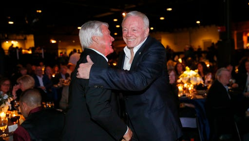 Dallas Cowboys owner Jerry Jones, right, and his former Super Bowl-winning coach Jimmy Johnson shake hands and hug following the 25th Anniversary of Super Bowl XXVII at Gilley's in Dallas, Saturday, Feb. 25, 2017.