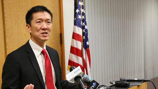 Hawaii Attorney General Douglas Chin speaks at a news conference Thursday, March 9, 2107, in Honolulu. Chin's office filed an amended lawsuit against President Donald Trump's revised travel ban.