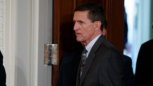 FILE - In this Feb. 13, 2017 file photo, Mike Flynn arrives for a news conference in the East Room of the White House in Washington. Flynn, President Donald Trump's former national security adviser, who was fired from the White House last month, has registered as a foreign agent with the Justice Department for work that may have aided the Turkish government in exchange for $530,000.