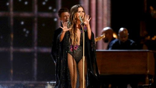 "FILE - In this Sunday, Feb. 12, 2017, file photo, Maren Morris performs ""Once"" at the 59th annual Grammy Awards in Los Angeles. Brothers Osborne, Morris and Jon Pardi are early winners at this year's Academy of Country Music Awards. The ACMs announced on Tuesday, March 14, 2017, the winners of their new artist categories including new vocal duo or group of the year, new female vocalist of the year and new male vocalist of the year."