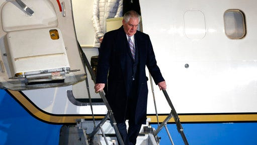 U.S. Secretary of State Rex Tillerson, center, arrives at Haneda international airport in Tokyo, as the first stop of his tour to Asia, Wednesday, March 15, 2017.