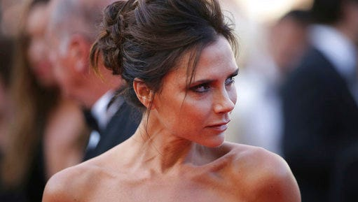 FILE - In this Wednesday, May 11, 2016, file photo, fashion designer Victoria Beckham arrives for the screening of the film Cafe Society at the 69th international film festival, Cannes, southern France. Target is counting on Victoria Beckham to spice up sales. On Wednesday, March 15, 2017, the Minneapolis-based designer offered a first look into the pop star's collection that hits stores and online starting April 9, 2017.