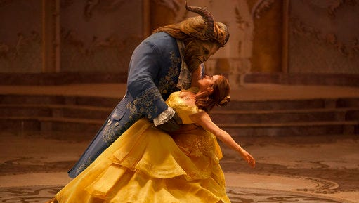 """This image released by Disney shows Dan Stevens as The Beast, left, and Emma Watson as Belle in a live-action adaptation of the animated classic """"Beauty and the Beast."""" Disney's film Beauty and the Beast has been pulled from cinemas in Kuwait after the country's censors raised concerns over the film's content. Duaij Al-Khalifa Al-Sabah, a board member at the National Cinema Company that operates 11 of Kuwait's 13 movie theaters, told The Associated Press on Monday, March 20, 2017 a newly edited version of the movie may be back in theaters later this week."""