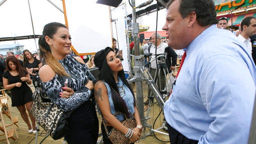 "FILE – In this May 24, 2013, file photo, New Jersey Gov. Chris Christie, right, speaks with Nicole ""Snooki"" Polizzi, center, and Jenni ""JWoww"" Farley, left, cast members of MTV's ""Jersey Shore,"" on the boardwalk where he took part in a ribbon-cutting ceremony marking the New Jersey shore's seasonal reopening for the first time since Hurricane Sandy in Seaside Heights, N.J. Under legislation inspired by reality TV star Polizzi, no more than $10,000 of state money could go to pay speakers at New Jersey's public universities. New Jersey's Democrat-controlled Assembly was scheduled to vote Thursday, March 23, 2017, on whether to send the bill to Christie's desk."
