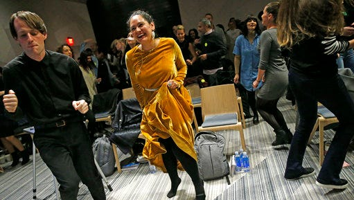 In this March 8, 2017 photo, Andrew Hoepfner, left, and Pamela Martinez, center, dances along with participants at a sober social event sponsored by The Shine at a hotel in the Williamsburg neighborhood of the Brooklyn borough of New York. Alcohol-free events, which are popping up in New York, Los Angeles and Chicago, are part of a trend fueled by millennials seeking to find meaningful connections while they party.
