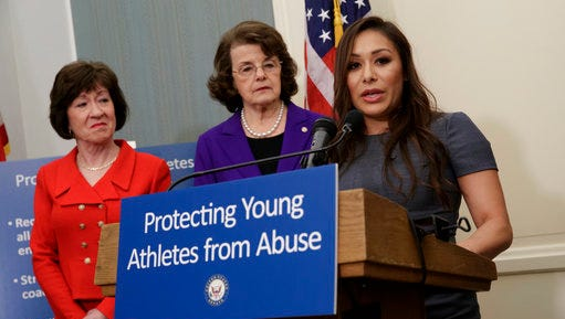 Former Team USA gymnast Jeanette Antolin, right, accompanied by Sen. Susan Collins, R-Maine, left, and Sen. Dianne Feinstein, D-Calif., ranking member on the Senate Judiciary Committee, speaks during a news conference on Capitol Hill in Washington, Tuesday, March 28, 2017, to call on Congress to pass legislation that would require amateur athletics governing bodies to immediately report sex-abuse allegations to law enforcement and strengthen oversight of member gymnasiums and coaches.