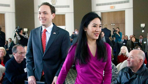 FILE - In this Jan. 28, 2014 file photo, Clay Pell, left, grandson of the late Sen. Claiborne Pell, D-RI, and his wife, two-time Olympic figure skating medalist Michelle Kwan, right, enter the Rhode Island Convention Center in Providence, R.I., to begin his campaign for governor of Rhode Island. Clay Pell said in a statement Wednesday, March 29, 2017, that the couple is getting a divorce after four years of marriage.