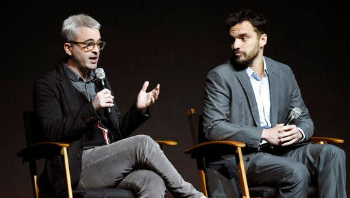 """Alex Kurtzman, left, director of the upcoming film """"The Mummy,"""" and cast member Jake Johnson discuss the film during the Universal Pictures presentation at CinemaCon 2017 at Caesars Palace on Wednesday, March 29, 2017, in Las Vegas."""