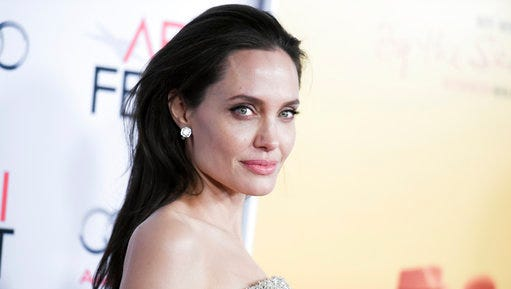 """FILE - In this Nov. 5, 2015m file photo, actress and director Angelina Jolie Pitt arrives at the 2015 AFI Fest opening night premiere of """"By The Sea,"""" in Los Angeles. To help shed her early reputation, Jolie agreed to be drug tested during production of 2001's """"Lara Croft: Tomb Raider,"""" according to a new book. The Hollywood Reporter on Wednesday, March 29, 2017, released an excerpt from an upcoming biography of the former studio head Sherry Lansing, """"Leading Lady."""" Lansing stepped down as Paramount Pictures chairman and chief executive in 2005."""