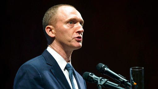 "FILE - In this Friday, July 8, 2016, file photo, Carter Page, then adviser to U.S. Republican presidential candidate Donald Trump, speaks at the graduation ceremony for the New Economic School in Moscow, Russia. A foreign policy adviser to Donald Trump's presidential campaign met with a Russian intelligence operative in 2013 and provided him documents about the energy industry, according to court filings. The Russian, Victor Podobnyy, was one of three men charged in connection with a Cold War-style Russian spy ring. According to the court documents, Podobnyy tried to recruit Page, an energy consultant working in New York at the time, as an intelligence source. Page is referred to in the filing as ""Male-1."""