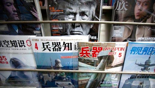A magazine featuring U.S. President Donald Trump is on display with Chinese military magazines at a newsstand in Beijing, China, Tuesday, April 4, 2017. President Donald Trump's upcoming summit with China's leader will be closely watched for signs of how relations between the world's top two economies will proceed as they tackle weighty questions over trade, North Korea and the South China Sea.
