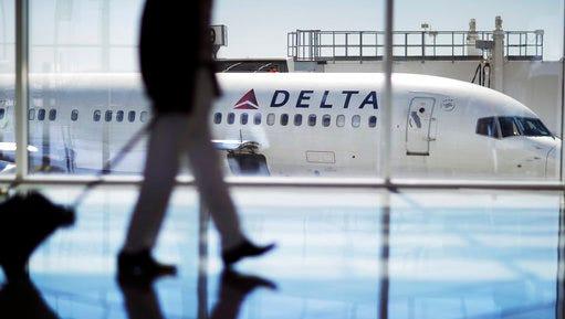 In this file photo, a Delta Air Lines jet sits at a gate at Hartsfield-Jackson Atlanta International Airport in Atlanta.
