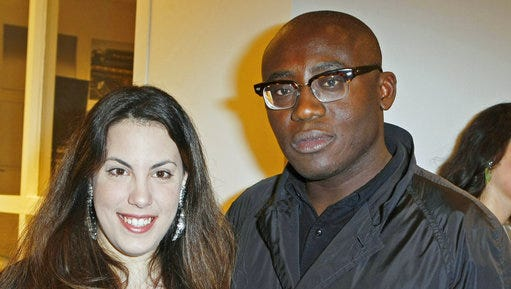 FILE - In this Tuesday, Jan. 24, 2012 file photo, fashion designer Mary Katrantzou, left, poses with magazine director Edward Enninful at a Longchamp cocktail party as part of the Haute Couture Fashion Week in Paris. British Vogue's search for a new leader has come to an end with the naming of Edward Enninful as the magazine's new chief editor, it was announced on Monday, April 10, 2017. He will be the first male editor of British Vogue. Enninful, who had been the creative and fashion director at W magazine, has been an influential magazine fashion director for more than 20 years.