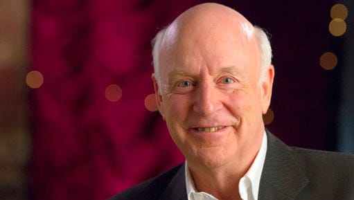 In this undated photo provided by the Australian Broadcasting Corporation, John Clarke, a comedian and political satirist beloved in Australia and New Zealand, poses for a photo. Clarke's family said the 68-year-old died on Sunday, April 9, 2017, of natural causes while taking photographs of birds in the Grampians National Park, a three-hour drive from his home in Melbourne, Australia.