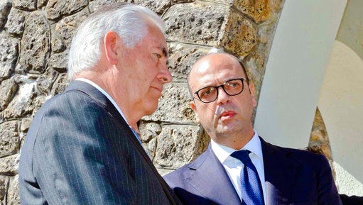 U.S. Secretary of State Rex Tillerson, left, and Italian Foreign Minister Angelino Alfano, talk to each other after laying a wreath at a memorial in Santa' Anna di Stazzema, a site of Nazi atrocities where 560 civilians, including some 130 children, were killed during World War II, Monday, April 10, 2017. Foreign ministers from the Group of Seven industrialized nations are gathering in Lucca for a meeting given urgency by the chemical attack in Syria and the U.S. military response, with participants aiming to pressure Russia to end its support for President Bashar Assad.