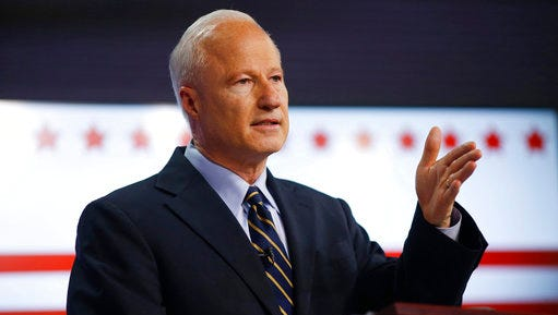 FILE - In this Tuesday, Oct. 4, 2016 file photo, U.S. Congressman Mike Coffman, R-Colo., makes a point during a debate with his opponent for Colorado's 6th Congressional District seat, Democrat Morgan Carroll, at a Spanish language television station in Denver. Coffman, one of the few swing district Republican representatives in the country, will be holding a town hall meeting with constituents on Wednesday, April 12, 2017.