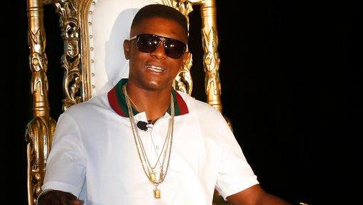 FILE - In this March 10, 2014 file photo, rapper Lil' Boosie appears at a news conference in New Orleans. Boosie, now goes by the name Boosie Badazz, accused police of improperly taking the rapper's jewelry on Tuesday, April 11, 2017.  Biloxi Police Lt. Christopher De Back says Boosie Badazz's jewelry was impounded Sunday when officers arrested five members of the rapper's entourage for assault. De Back says Boosie didn't participate in the assault.