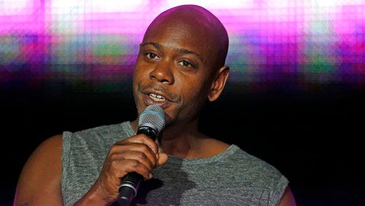 FILE - This Sunday, July 6, 2014 file photo, Dave Chappelle performs at the Essence Festival in New Orleans. Chappelle teamed up with John Mayer to remember late comedian Charlie Murphy at Mayer's concert in Columbus, Ohio, on April 12, 2017. Murphy died the same day.